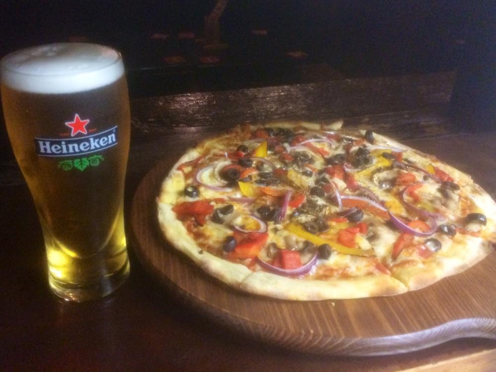 Pizzas at the Strand Bar  - September offer Pizza plus pint Heineken or glass wine